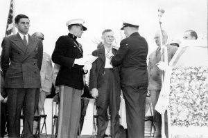 Ross Gray's father receiving his son's award from Rear Admiral A. S. Merrill.