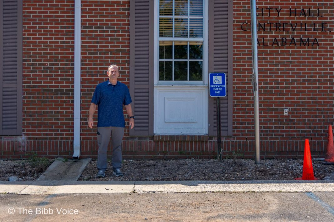 Centreville Mayor Terry Morton stands outside the City Hall window that will become the new drive-thru.